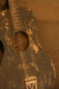 dusty_guitar_by_greensh1